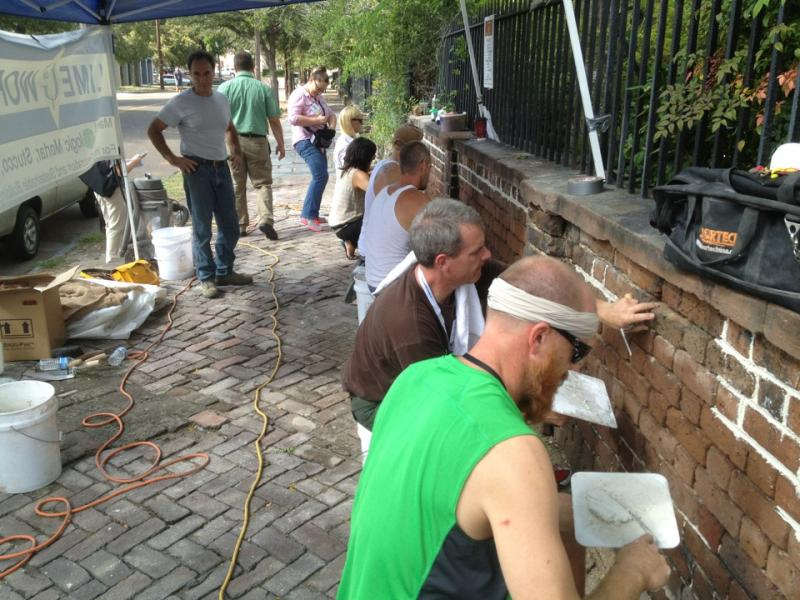 """During"" the workshop at 2nd Presbyterian Church, Charleston where many volunteers came out to use a pure lime mortar placed between the bricks and finished to the orginal profile of the joints"